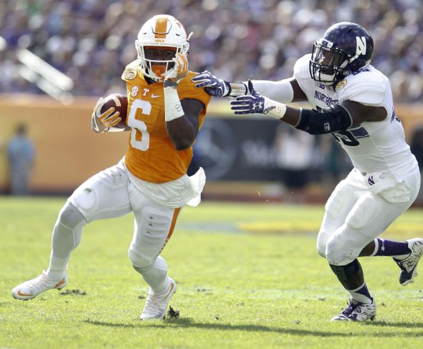 Jan 1, 2016; Tampa, FL, USA; Tennessee Volunteers running back Alvin Kamara (6) runs the ball against Northwestern Wildcats linebacker Drew Smith (55) in the first quarter at the 2016 Outback Bowl at Raymond James Stadium. Mandatory Credit: Mark Zerof-USA TODAY Sports