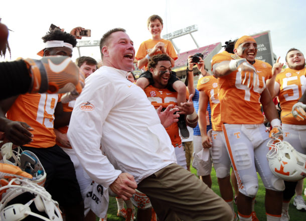 Jan 1, 2016; Tampa, FL, USA; Tennessee Volunteers head coach Butch Jones and his team celebrate as they beat the Northwestern Wildcats in the 2016 Outback Bowl at Raymond James Stadium. Tennessee Volunteers defeated the Northwestern Wildcats 45-6. Tennessee Volunteers Mandatory Credit: Kim Klement-USA TODAY Sports