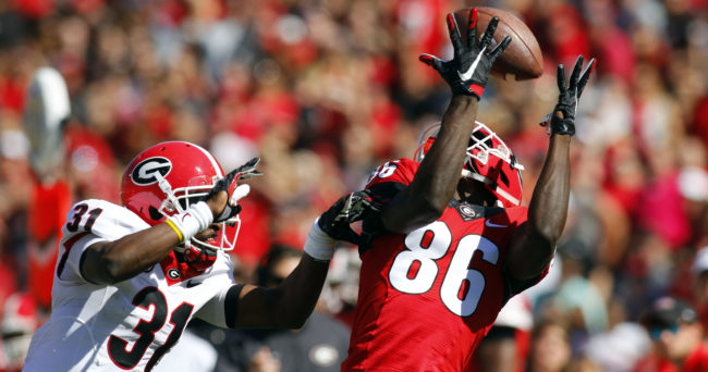 Apr 16, 2016; Athens, GA, USA; Georgia Bulldogs wide receiver Riley Ridley (86) catches a pass over cornerback Shattle Fenteng (31) during the first half of the spring game at Sanford Stadium. Mandatory Credit: Brett Davis-USA TODAY Sports