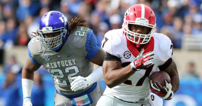 Nov 8, 2014; Lexington, KY, USA; Georgia Bulldogs running back Nick Chubb (27) runs the ball against Kentucky Wildcats linebacker Khalid Henderson (22) in the first half at Commonwealth Stadium. Mandatory Credit: Mark Zerof-USA TODAY Sports