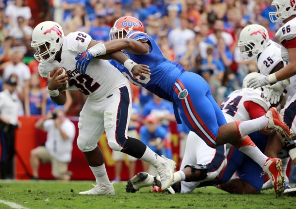 Nov 21, 2015; Gainesville, FL, USA; Florida Gators defensive lineman Cece Jefferson (96) tackles Florida Atlantic Owls quarterback Jaquez Johnson (32) during the second quarter at Ben Hill Griffin Stadium. Mandatory Credit: Kim Klement-USA TODAY Sports