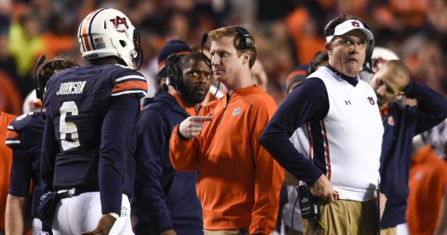Nov 21, 2015; Auburn, AL, USA; Auburn Tigers offensive coordinator Rhett Lashlee (middle) speaks with quarterback Jeremy Johnson (6) after his touchdown as head coach Gus Malzahn stands by during the third quarter against the Idaho Vandals at Jordan Hare Stadium. Auburn won 56-34. Mandatory Credit: Shanna Lockwood-USA TODAY Sports