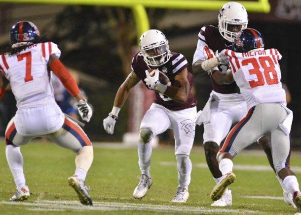Nov 28, 2015; Starkville, MS, USA; Mississippi State Bulldogs wide receiver Fred Ross (8) runs the ball during the third quarter of the game against the Mississippi Rebels at Davis Wade Stadium. Mississippi won 38-27. Mandatory Credit: Matt Bush-USA TODAY Sports