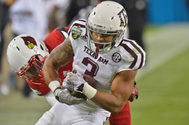 Dec 30, 2015; Nashville, TN, USA;Texas A&M Aggies wide receiver Christian Kirk (3) rushes for a touchdown against Louisville Cardinals safety Chucky Williams (22) during the second half of the 2015 Music City Bowl at Nissan Stadium. Louisville won 27-21. Mandatory Credit: Jim Brown-USA TODAY Sports