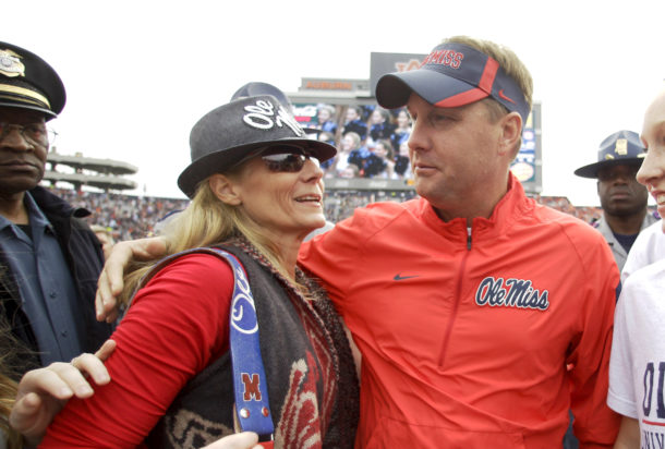 Oct 31, 2015; Auburn, AL, USA; Ole Miss Rebels head coach Hugh Freeze and wife Jill celebrate after the game against the Auburn Tigers at Jordan Hare Stadium. The Rebels beat the Tigers 27-19. Mandatory Credit: John Reed-USA TODAY Sports