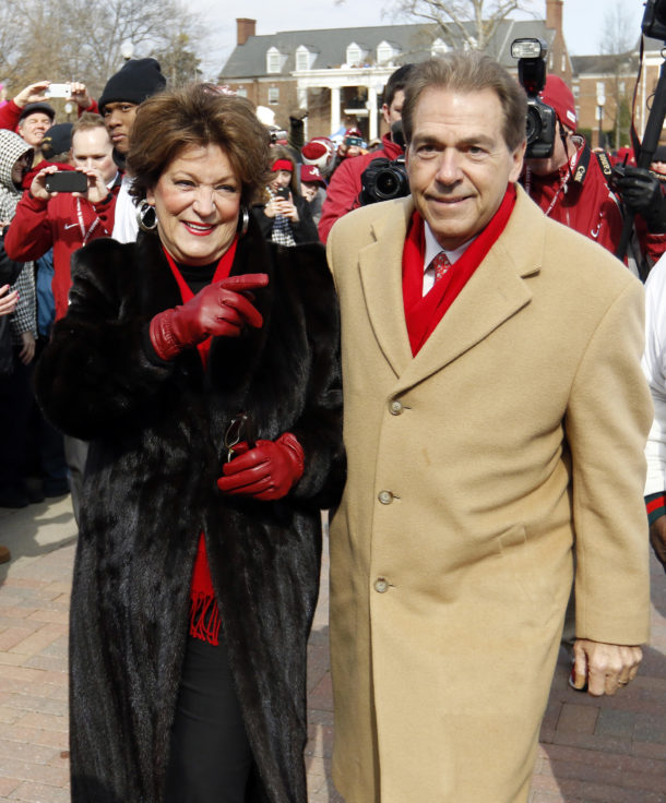 Jan 23, 2016; Tuscaloosa, AL, USA; Terry Saban waves to fans as she walks with Alabama head coach Nick Saban during a parade to celebrate the victory in the CFP National Championship game at Bryant-Denny Stadium. Mandatory Credit: Butch Dill-USA TODAY Sports