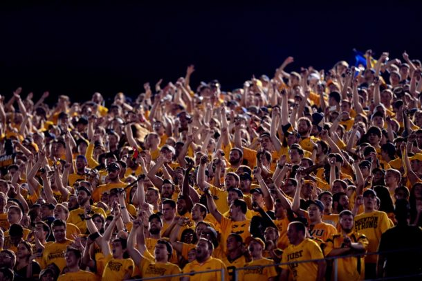 Sep 20, 2014; Morgantown, WV, USA; West Virginia Mountaineers fans celebrates after a touchdown during the first quarter against the Oklahoma Sooners at Milan Puskar Stadium. Mandatory Credit: Andrew Weber-USA TODAY Sports