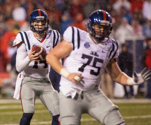 Nov 22, 2014; Fayetteville, AR, USA; Ole Miss Rebels quarterback Bo Wallace (14) looks to pass as offensive lineman Robert Conyers (75) blocks during a game against the Arkansas Razorbacks at Donald W. Reynolds Razorback Stadium. Arkansas defeated Ole Miss 30-0. Mandatory Credit: Beth Hall-USA TODAY Sports
