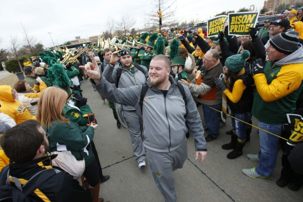 Jan 10, 2015; Frisco, TX, USA; North Dakota State Bison players walk through fans before the game against the Illinois State Redbirds at Pizza Hut Park. Mandatory Credit: Tim Heitman-USA TODAY Sports