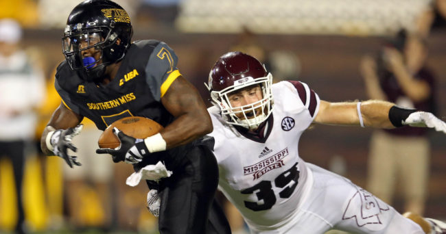 Sep 5, 2015; Hattiesburg, MS, USA; Southern Miss Golden Eagles running back Justice Hayes (7) is defended by Mississippi State Bulldogs linebacker Richie Brown (39) in the second half of their game at M.M. Roberts Stadium. Mississippi State won, 34-16. Mandatory Credit: Chuck Cook-USA TODAY Sports