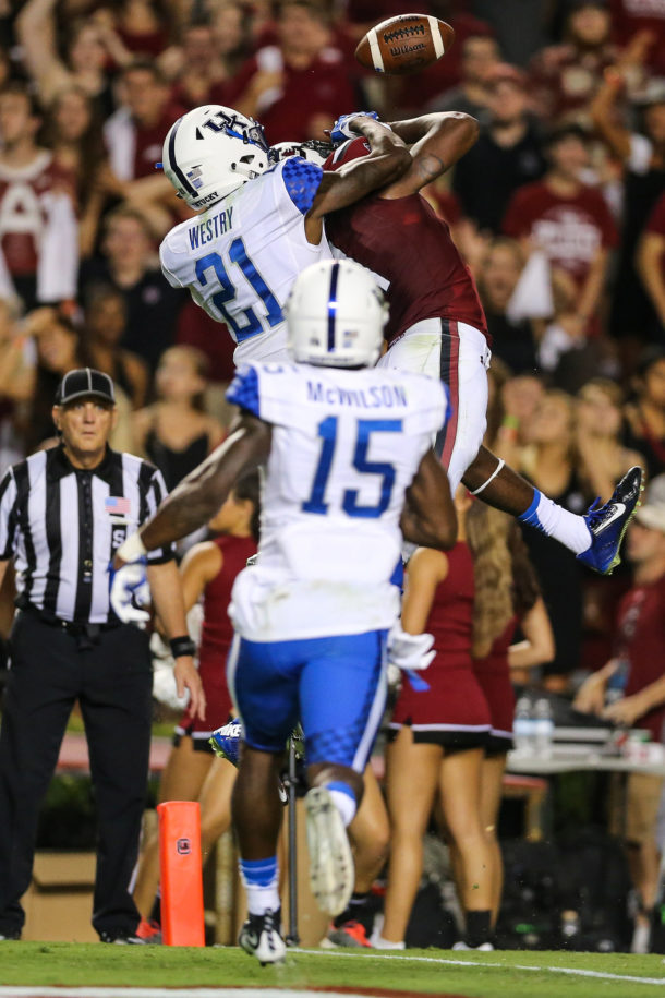 Sep 12, 2015; Columbia, SC, USA; South Carolina Gamecocks wide receiver Pharoh Cooper (11) has a pass broken up in the end zone by Kentucky Wildcats defensive back Chris Westry (21) during the second half at Williams-Brice Stadium. Kentucky wins 26-22 over South Carolina. Mandatory Credit: Jim Dedmon-USA TODAY Sports