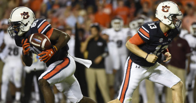 Sep 26, 2015; Auburn, AL, USA; Auburn Tigers wide receiver Marcus Davis (80) tries to maintain control after the handoff by Auburn Tigers quarterback Sean White (13)  during the first quarter at Jordan Hare Stadium. Mandatory Credit: Shanna Lockwood-USA TODAY Sports