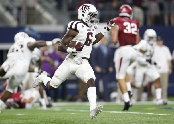 Sep 26, 2015; Arlington, TX, USA; Texas A&M Aggies nickel Donovan Wilson (6) runs back his interception in the second quarter against the Arkansas Razorbacks at AT&T Stadium. Mandatory Credit: Matthew Emmons-USA TODAY Sports