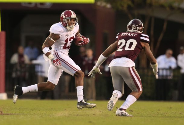 Nov 14, 2015; Starkville, MS, USA; Alabama Crimson Tide wide receiver ArDarius Stewart (13) carries the ball as Mississippi State Bulldogs defensive back Brandon Bryant (20) pursues him at Davis Wade Stadium. The Crimson Tide defeated the Bulldogs 31-6. Mandatory Credit: Marvin Gentry-USA TODAY Sports