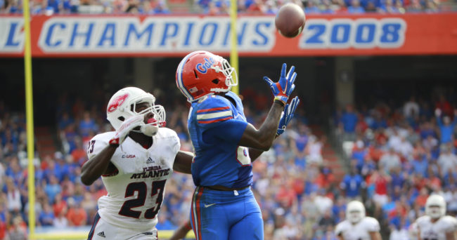 Nov 21, 2015; Gainesville, FL, USA; Florida Gators wide receiver Antonio Callaway (81) catches the ball over Florida Atlantic Owls defensive back Raekwon Williams (23) as he scores a touchdown during the second half at Ben Hill Griffin Stadium. Mandatory Credit: Kim Klement-USA TODAY Sports