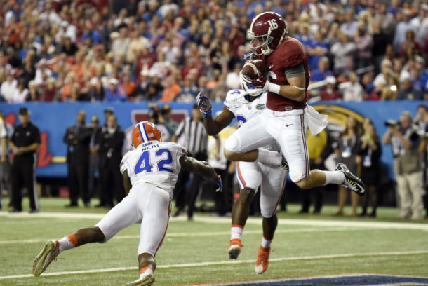Dec 5, 2015; Atlanta, GA, USA; Alabama Crimson Tide wide receiver Richard Mullaney (16) catches a 9 yard touchdown pass between Florida Gators defensive back Keanu Neal (42) and Brian Poole (24) in the fourth quarter in the 2015 SEC Championship Game at the Georgia Dome. Mandatory Credit: Dale Zanine-USA TODAY Sports