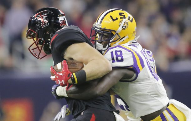 Dec 29, 2015; Houston, TX, USA; Texas Tech Red Raiders wide receiver Ian Sadler (12) is tackled by LSU Tigers cornerback Tre'Davious White (18) in the first quarter at NRG Stadium. Mandatory Credit: Thomas B. Shea-USA TODAY Sports
