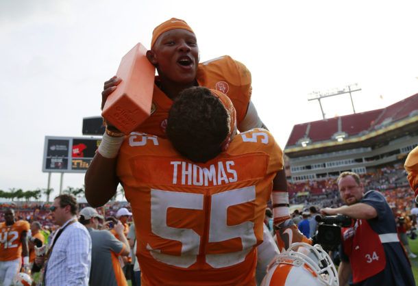Jan 1, 2016; Tampa, FL, USA; Tennessee Volunteers quarterback Joshua Dobbs (11) and offensive lineman Coleman Thomas (55) celebrate as they beat the Northwestern Wildcats in the 2016 Outback Bowl at Raymond James Stadium. Tennessee Volunteers defeated the Northwestern Wildcats 45-6. Tennessee Volunteers Mandatory Credit: Kim Klement-USA TODAY Sports
