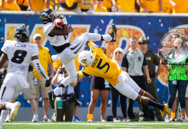 Sep 3, 2016; Morgantown, WV, USA; Missouri Tigers defensive back Aarion Penton (11) intercepts a pass intended for West Virginia Mountaineers wide receiver Jovon Durante (5) during the third quarter at Milan Puskar Stadium. Mandatory Credit: Ben Queen-USA TODAY Sports