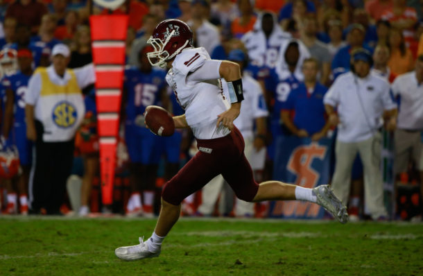 Sep 5, 2015; Gainesville, FL, USA; New Mexico State Aggies quarterback Tyler Rogers (17) runs with the ball against the Florida Gators during the second half at Ben Hill Griffin Stadium. Mandatory Credit: Kim Klement-USA TODAY Sports