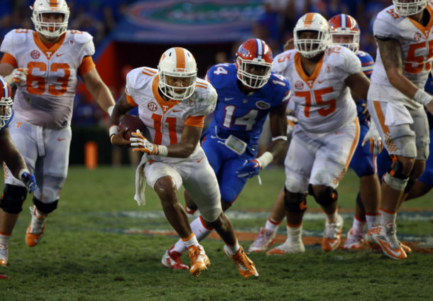 Sep 26, 2015; Gainesville, FL, USA; Tennessee Volunteers quarterback Joshua Dobbs (11) runs with the ball against the Florida Gators during the second half at Ben Hill Griffin Stadium. Florida Gators defeated the Tennessee Volunteers 28-27. Mandatory Credit: Kim Klement-USA TODAY Sports