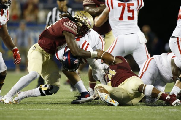 Sep 5, 2016; Orlando, FL, USA; Mississippi Rebels quarterback Chad Kelly (10) fumbles the ball after being hit by Florida State Seminoles defensive end DeMarcus Walker (44) in the third quarter at Camping World Stadium. Mandatory Credit: Logan Bowles-USA TODAY Sports