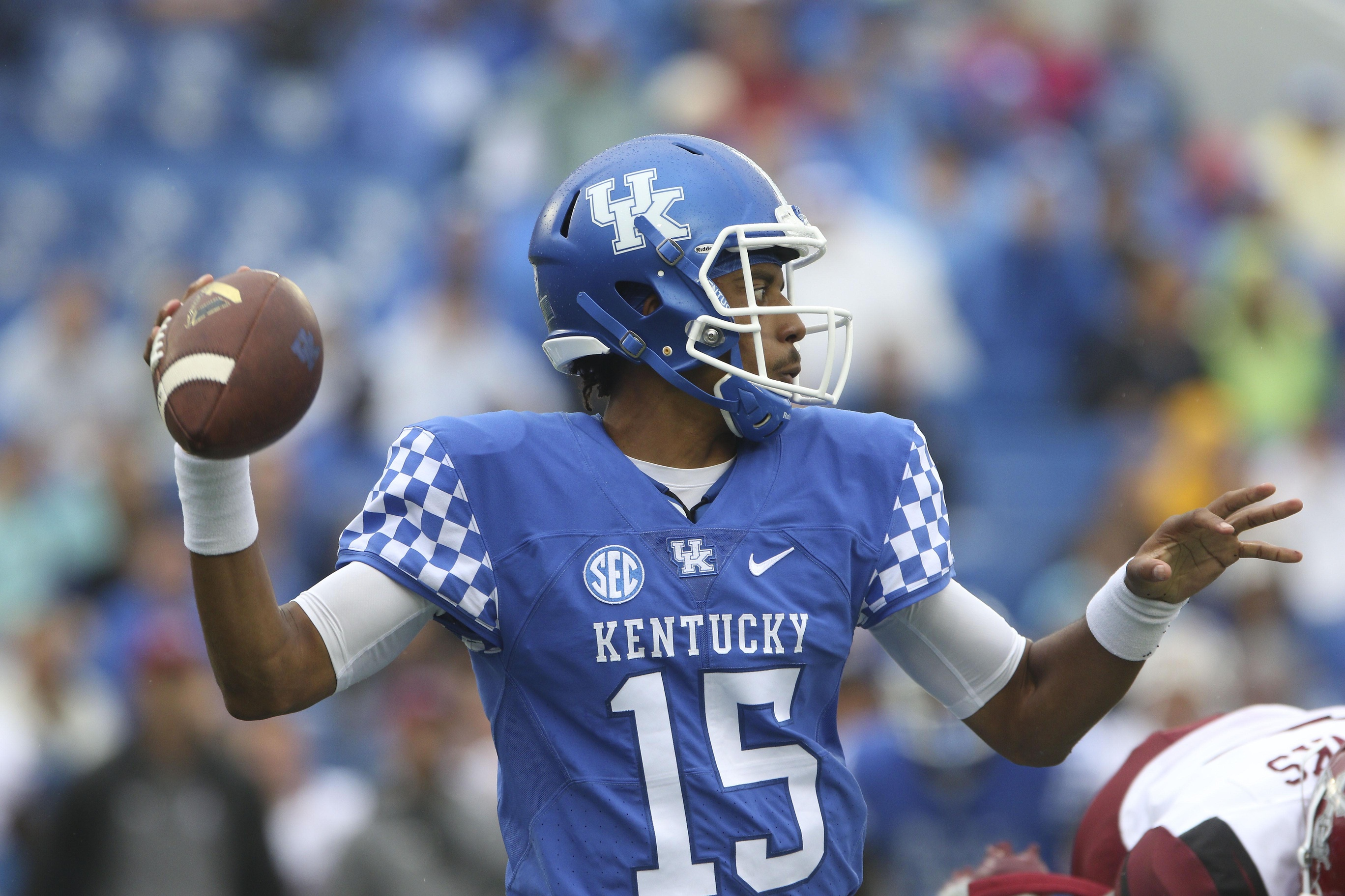 Sep 17, 2016; Lexington, KY, USA; Kentucky Wildcats quarterback Stephen Johnson (15) drops back to pass the ball against the New Mexico State Aggies in the first quarter at Commonwealth Stadium. Mandatory Credit: Mark Zerof-USA TODAY Sports