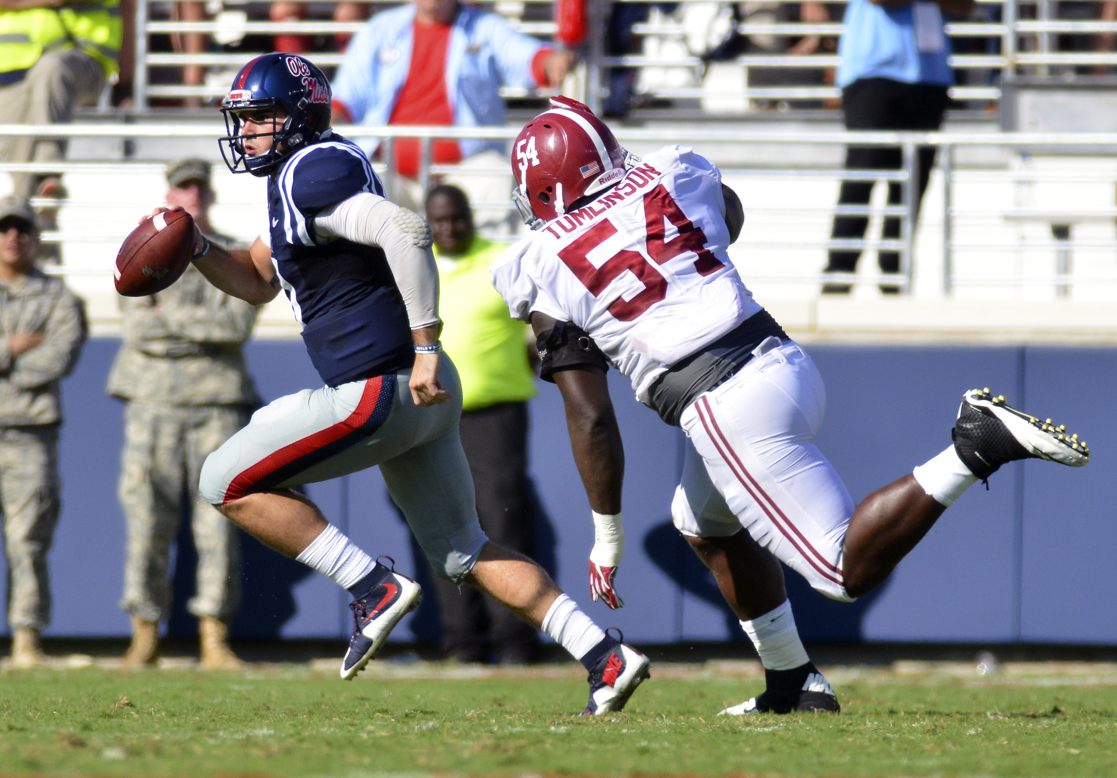 Sep 17, 2016; Oxford, MS, USA; Mississippi Rebels quarterback Chad Kelly (10) attempts to avoid Alabama Crimson Tide defensive lineman Dalvin Tomlinson (54) during the second quarter of the game at Vaught-Hemingway Stadium. Mandatory Credit: Matt Bush-USA TODAY Sports