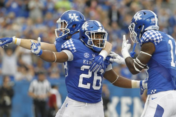 Sep 17, 2016; Lexington, KY, USA; Kentucky Wildcats running back Benny Snell Jr (26) celebrates with teammates after scoring a touchdown against the New Mexico State Aggies in the second half at Commonwealth Stadium. Kentucky defeated New Mexico State 62-42. Mandatory Credit: Mark Zerof-USA TODAY Sports