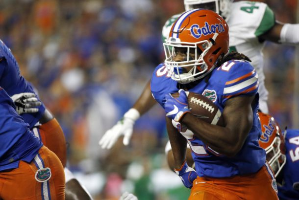 Sep 17, 2016; Gainesville, FL, USA; Florida Gators running back Jordan Scarlett (25) carries the ball against the North Texas Mean Green during the second quarter at Ben Hill Griffin Stadium. Mandatory Credit: Kim Klement-USA TODAY Sports