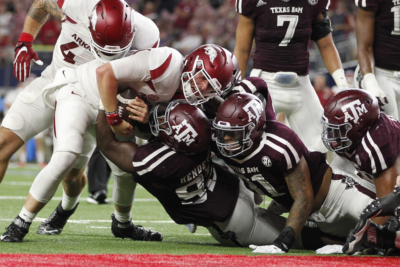 Sep 24, 2016; Dallas, TX, USA; Arkansas Razorbacks quarterback Austin Allen (8) is gang tackled at the one yard line in the third quarter by the Texas A&M Aggies defense at AT&T Stadium. Mandatory Credit: Tim Heitman-USA TODAY Sports