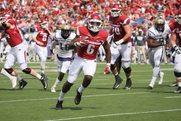 Oct 1, 2016; Little Rock, AR, USA; Arkansas Razorbacks running back T.J. Hammond (6) rushes for a touchdown in the fourth quarter against the Alcorn State Braves at War Memorial Stadium. Arkansas defeated Alcorn State 52-10. Mandatory Credit: Nelson Chenault-USA TODAY Sports