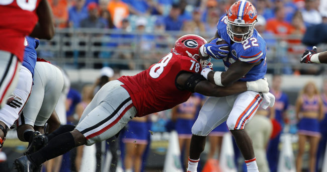 Oct 29, 2016; Jacksonville, FL, USA; Florida Gators running back Lamical Perine (22) runs with the ball as Georgia Bulldogs defensive tackle Trenton Thompson (78) defends during the first half at EverBank Field. Mandatory Credit: Kim Klement-USA TODAY Sports