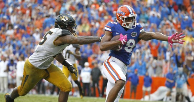 Oct 15, 2016; Gainesville, FL, USA; Florida Gators wide receiver Tyrie Cleveland (89) carries the ball to score touchdown in front of Missouri Tigers linebacker Donavin Newsom (25) during the second half at Ben Hill Griffin Stadium. The Gators won 40-14. Mandatory Credit: Kim Klement-USA TODAY Sports