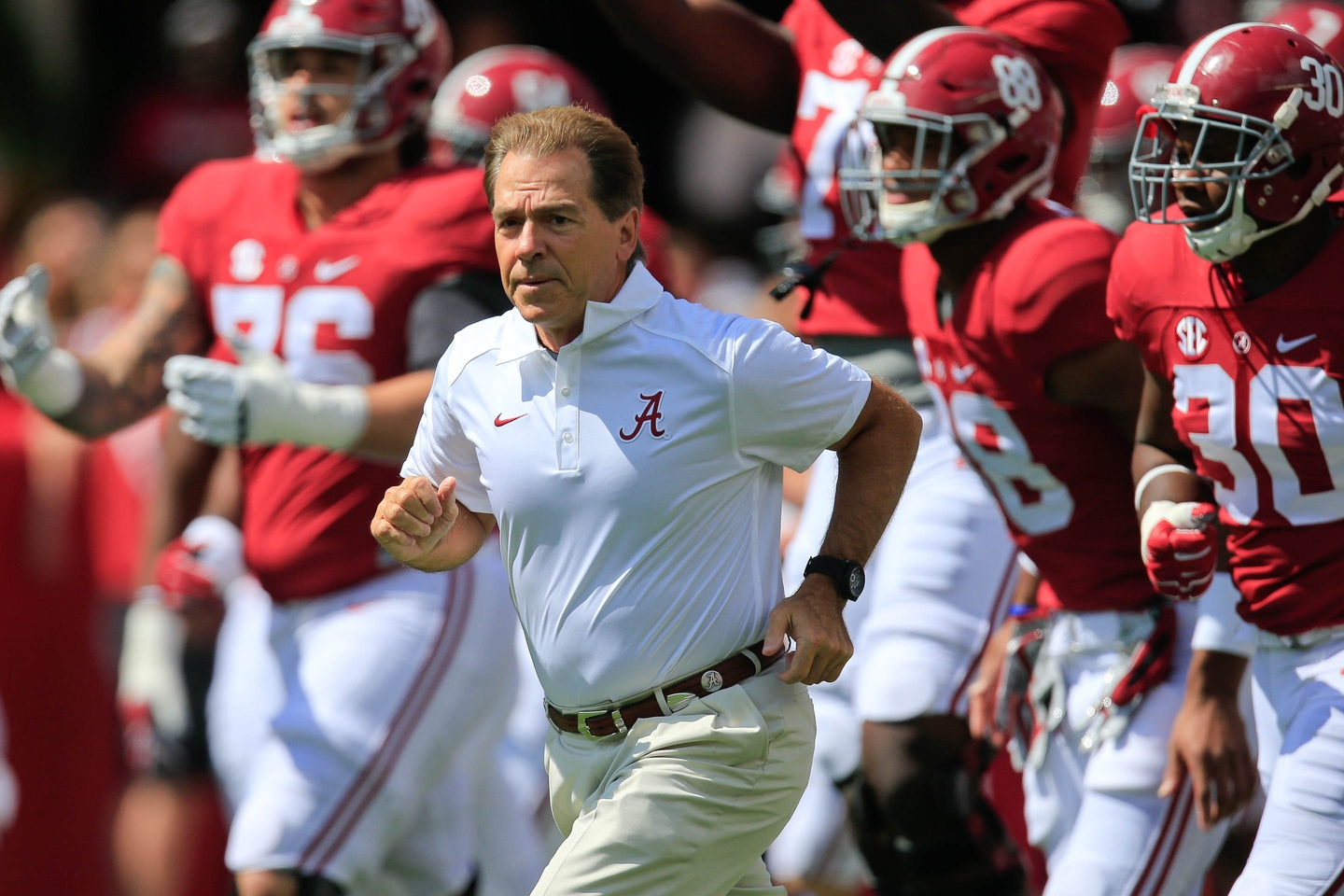 Sep 12, 2015; Tuscaloosa, AL, USA; Alabama Crimson Tide head coach Nick Saban brings his team onto the field prior to the game against Middle Tennessee Blue Raiders at Bryant-Denny Stadium. Mandatory Credit: Marvin Gentry-USA TODAY Sports