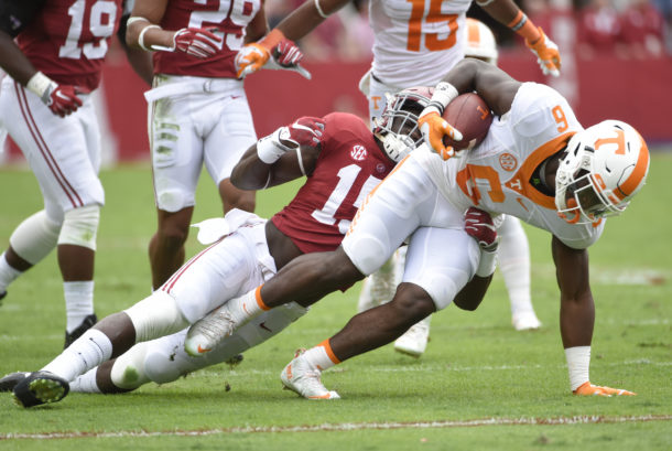 Oct 24, 2015; Tuscaloosa, AL, USA; Tennessee Volunteers running back Alvin Kamara (6) carries the ball against Alabama Crimson Tide defensive back Ronnie Harrison (15) during the first quarter at Bryant-Denny Stadium. Mandatory Credit: John David Mercer-USA TODAY Sports