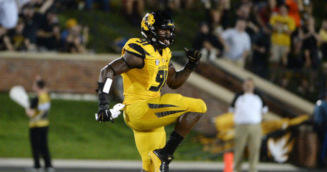 Sep 17, 2016; Columbia, MO, USA; Missouri Tigers defensive end Charles Harris (91) celebrates after a sack against the Georgia Bulldogs in the first half at Faurot Field. Mandatory Credit: John Rieger-USA TODAY Sports