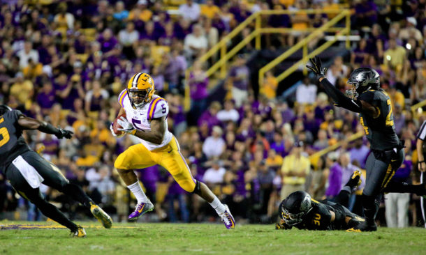 Oct 1, 2016; Baton Rouge, LA, USA; LSU Tigers running back Derrius Guice (5) breaks a tackle by Missouri Tigers linebacker Michael Scherer (30) during the second half of a game at Tiger Stadium. LSU defeated Missouri 42-7. Mandatory Credit: Derick E. Hingle-USA TODAY Sports