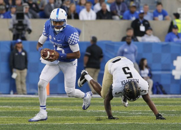 Oct 8, 2016; Lexington, KY, USA; Kentucky Wildcats quarterback Stephen Johnson (15) runs the ball against Vanderbilt Commodores cornerback Torren McGaster (5) in the second half at Commonwealth Stadium. Kentucky defeated Vanderbilt 20-13. Mandatory Credit: Mark Zerof-USA TODAY Sports