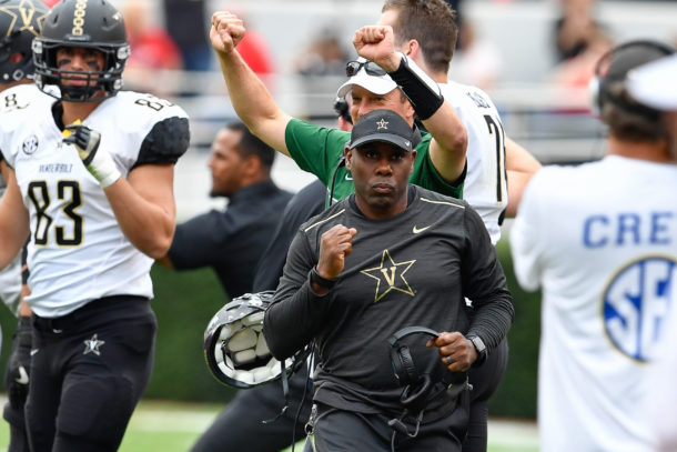 Oct 15, 2016; Athens, GA, USA; Vanderbilt Commodores head coach Derek Mason pumps his fist reacting to a defensive stop against the Georgia Bulldogs at the end of the fourth quarter at Sanford Stadium. Vanderbilt defeated Georgia 17-16. Mandatory Credit: Dale Zanine-USA TODAY Sports