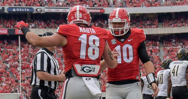 Oct 15, 2016; Athens, GA, USA; Georgia Bulldogs tight end Isaac Nauta (18) reacts with quarterback Jacob Eason (10) after catching a touchdown against the Vanderbilt Commodores during the second half at Sanford Stadium. Vanderbilt defeated Georgia 17-16. Mandatory Credit: Dale Zanine-USA TODAY Sports