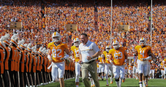 Oct 15, 2016; Knoxville, TN, USA; Tennessee Volunteers head coach Butch Jones runs on to the field before the game against the Alabama Crimson Tide at Neyland Stadium. Mandatory Credit: Randy Sartin-USA TODAY Sports