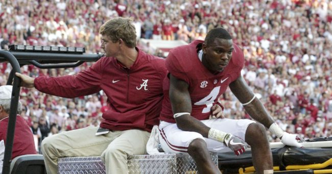 Oct 22, 2016; Tuscaloosa, AL, USA; Alabama Crimson Tide defensive back Eddie Jackson (4) is carted off the field after being injured against Texas A&M Aggies at Bryant-Denny Stadium. Mandatory Credit: Marvin Gentry-USA TODAY Sports