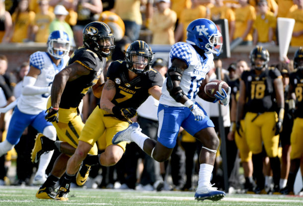 Oct 29, 2016; Columbia, MO, USA; Kentucky Wildcats running back Stanley Williams (18) runs in for a touchdown as Missouri Tigers safety Cam Hilton (7) and linebacker Donavin Newsom (25) attempt the tackle during the first half at Faurot Field. Mandatory Credit: Denny Medley-USA TODAY Sports