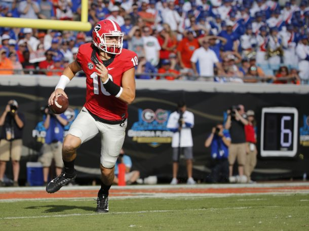 Oct 29, 2016; Jacksonville, FL, USA; Georgia Bulldogs quarterback Jacob Eason (10) runs out of the pocket against the Florida Gators during the first half at EverBank Field. Mandatory Credit: Kim Klement-USA TODAY Sports