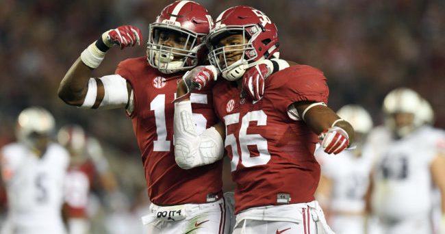Nov 26, 2016; Tuscaloosa, AL, USA;  Alabama Crimson Tide defensive back Ronnie Harrison (15) and linebacker Tim Williams (56) celebrate their tackles behind the Auburn Tigers line during the third quarter at Bryant-Denny Stadium. Alabama defeated the Auburn Tigers 30-12. Mandatory Credit: John David Mercer-USA TODAY Sports