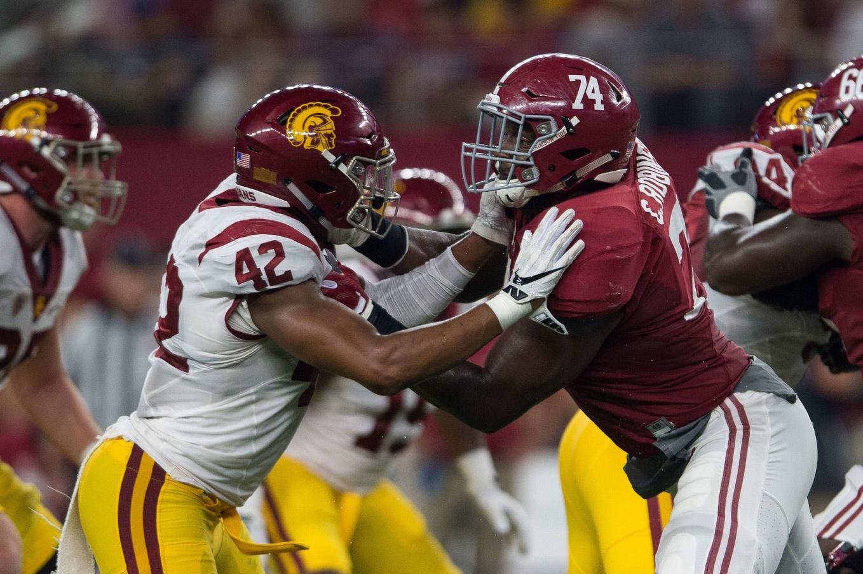 Sep 3, 2016; Arlington, TX, USA; Alabama Crimson Tide offensive lineman Cam Robinson (74) blocks USC Trojans linebacker Uchenna Nwosu (42) during the game at AT&T Stadium. Alabama defeats USC 52-6. Mandatory Credit: Jerome Miron-USA TODAY Sports