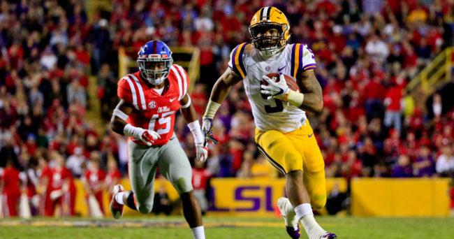 Oct 22, 2016; Baton Rouge, LA, USA; LSU Tigers running back Derrius Guice (5) runs past Mississippi Rebels defensive back Myles Hartsfield (15) during the second half of a game at Tiger Stadium. LSU defeated Mississippi 38-21. Mandatory Credit: Derick E. Hingle-USA TODAY Sports