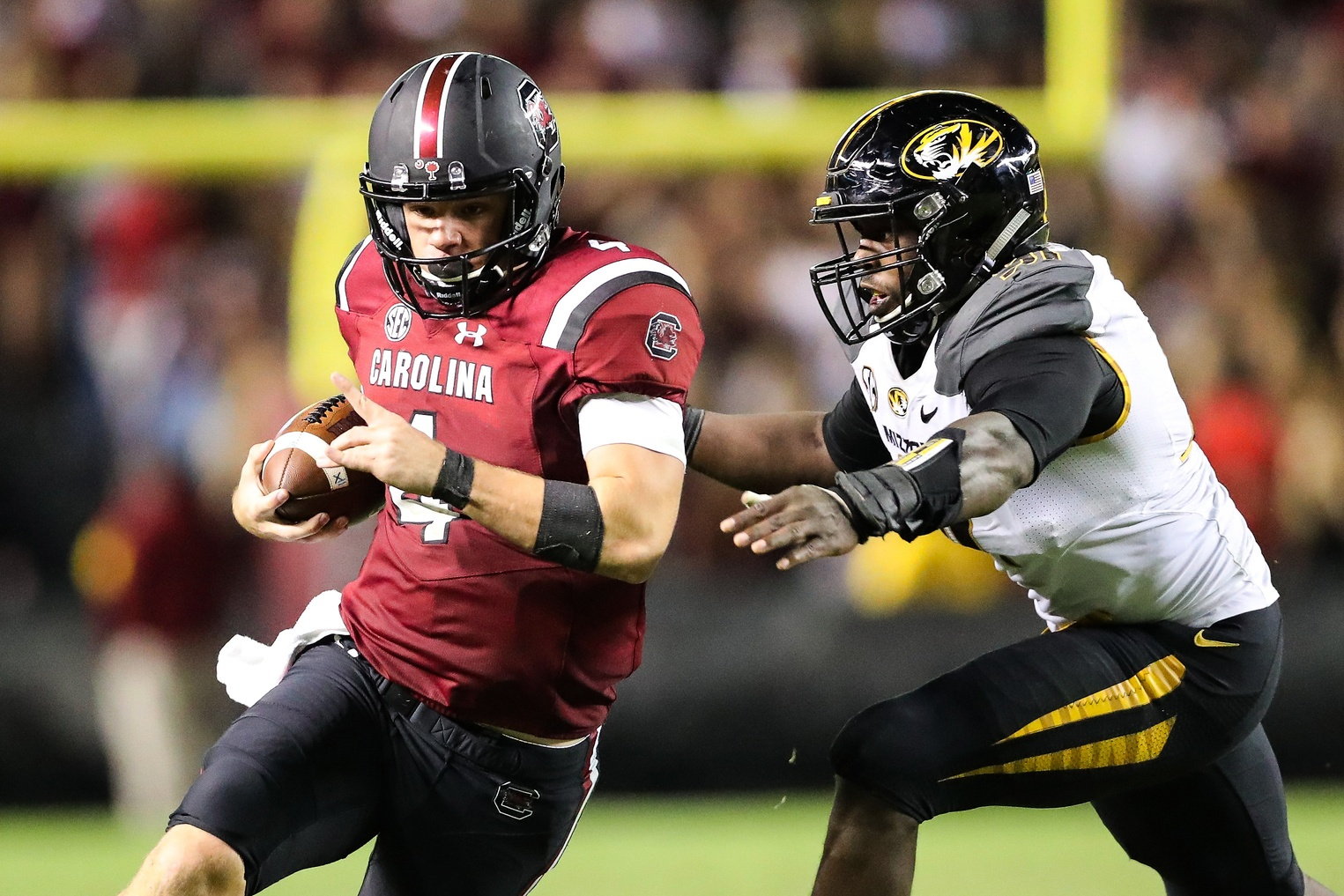 Nov 5, 2016; Columbia, SC, USA; South Carolina Gamecocks quarterback Jake Bentley (4) tries to outrun Missouri Tigers defensive end Charles Harris (91) during the second half at Williams-Brice Stadium. South Carolina wins 31-21 over Missouri. Mandatory Credit: Jim Dedmon-USA TODAY Sports