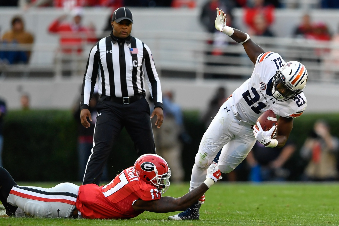 Nov 12, 2016; Athens, GA, USA; Auburn Tigers running back Kerryon Johnson (21) is tackled by Georgia Bulldogs linebacker Davin Bellamy (17) during the second quarter at Sanford Stadium. Mandatory Credit: Dale Zanine-USA TODAY Sports